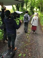 Crew films young actors walking down country road in Ireland 1-1